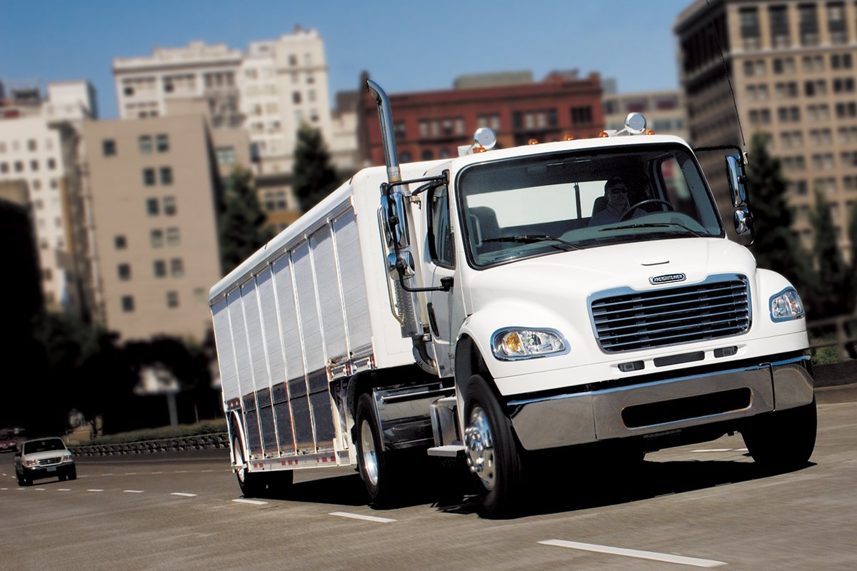 Freightliner truck equipped with an Allison transmission delivering beverages.