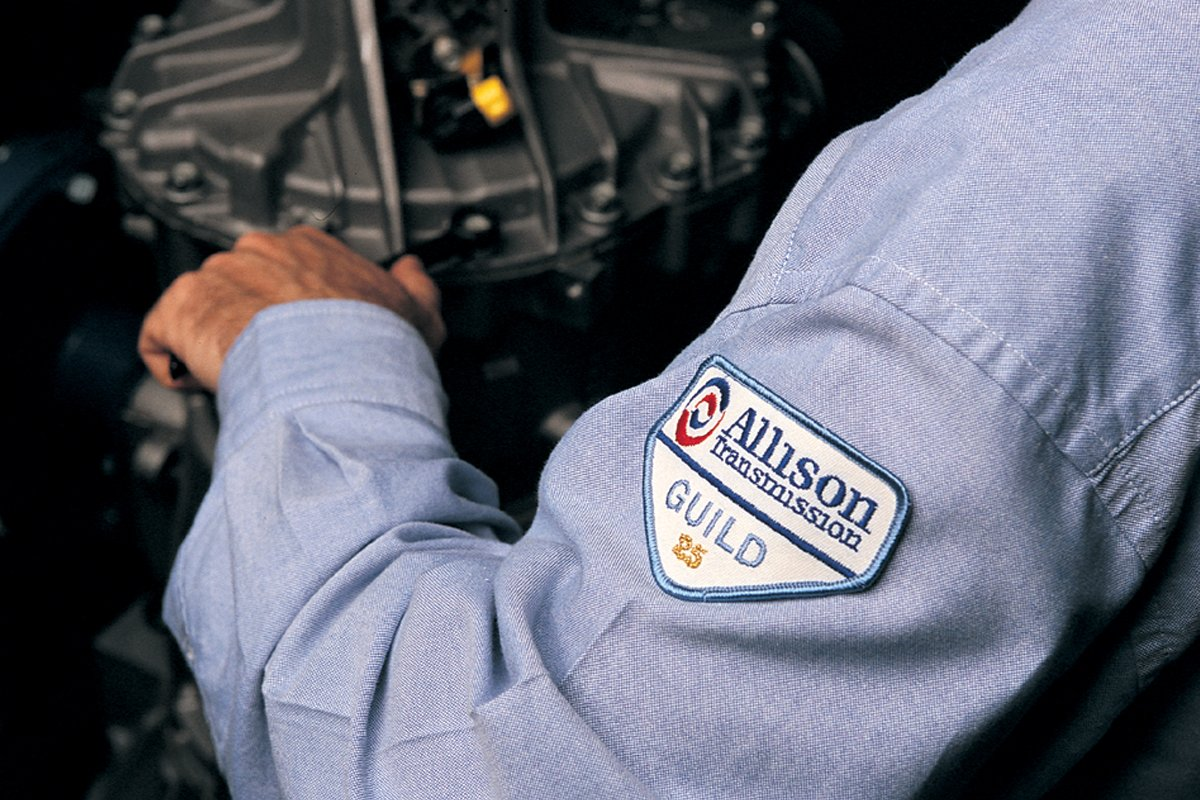 Person operating on an Allison transmission.